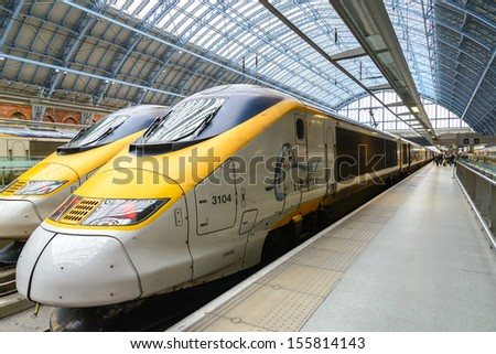 LONDON - MARCH 5: Eurostar train at St Pancras station on March 5, 2012 in London. Traffic between London and Paris was disrupted by wiring problems in France.  - stock photo
