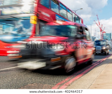 LONDON - MARCH 31, 2016: Red Bus And Taxi Cab Motion Blur. London Transport Concept.  - stock photo