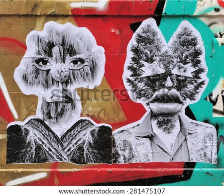 LONDON - MARCH 22, 2015. Street art in Hanbury Street Shoreditch in the Borough of Tower Hamlets, an area renown for its paintings and posters in east London, UK. - stock photo