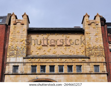 LONDON - MARCH 22, 2015. The decorative upper facade of the Whitechapel Gallery, designed by Charles Harrison Townsend, a venue for temporary exhibitions founded in 1901 located in east London. - stock photo