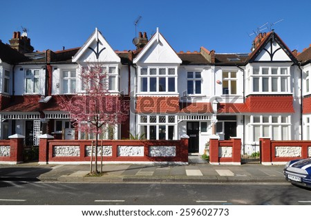 LONDON - MARCH 3. 2015. Typical small Edwardian period terraced houses built in 1913 in Rosedew Road on the Crabtree Estate, in the Borough of Hammersmith & Fulham, west London, UK. - stock photo