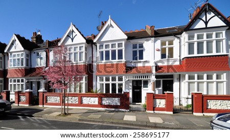 LONDON - MARCH 3. 2015. Typical small Edwardian period terraced houses built in 1913 on the Crabtree Estate, in the Borough of Hammersmith & Fulham, London, UK. - stock photo
