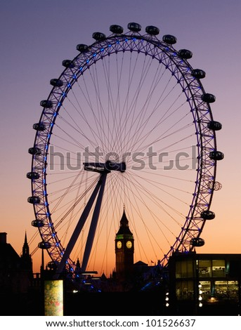LONDON - MARCH 7: View of London Eye and Big Ben on March 7, 2011 in London, England. London Eye is a famous tourist attraction at a height of 135 metres (443 ft) the biggest Ferris wheel in Europe - stock photo