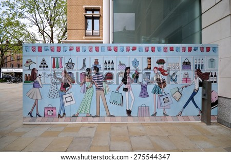 LONDON - MAY 2, 2015. A painted illustrative temporary timber hoarding at a retail shopping precinct on the King's Road in the Royal Borough of Kensington & Chelsea, London, UK. - stock photo