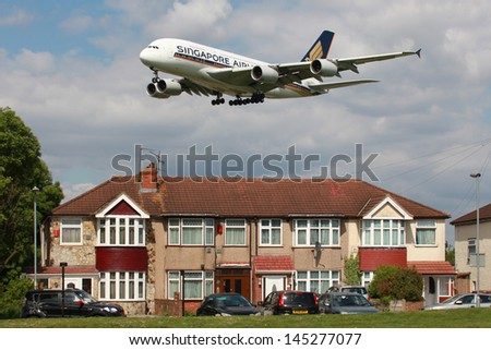 LONDON - MAY 25: A Singapore Airlines Airbus A380 on approach on May 25, 2013 in London. The Airbus A380 is the world's largest passenger airliner. Singapore Airlines is the flag carrier of Singapore. - stock photo