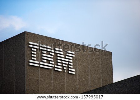 LONDON - MAY 21: IBM logo on the IBM Client Centre building on May 21, 2013 in London, UK. IBM is an American multinational technology and consulting corporation.  - stock photo