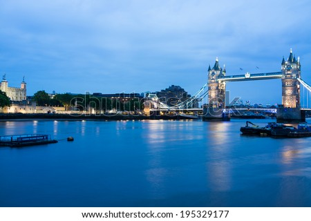 LONDON - MAY 26 : London Tower Bridge and Thames river pictured on May 26th, 2014, in London, UK. Built in 1886, it is a combined bascule and suspension bridge in London over the River Thames. - stock photo