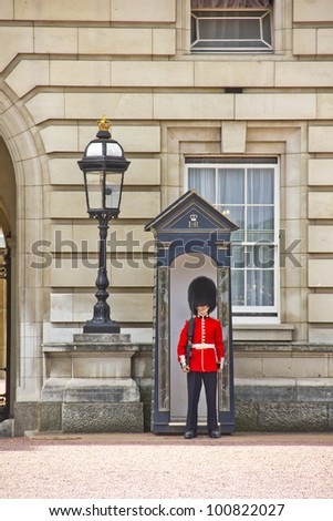 LONDON - MAY 12: Sentry of the Grenadier Guards posted outside of Buckingham Palace on May 12, 2011 in London, UK. The soldiers are charged with guarding the official royal residences in London. - stock photo