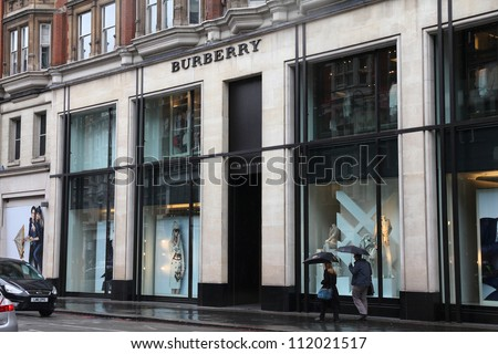LONDON - MAY 14: Shoppers visit Burberry store on May 14, 2012 in London. Burberry exists since 1856 and has 473 stores. Business Weekly claims Burberry is the 98th most valuable brand worldwide. - stock photo