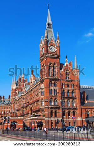 LONDON - MAY 18: St Pancras Station with unidentified people on May 18, 2014 in London. One of the main stations, at opening 1868 the arched Barlow train shed was largest single-span roof in the world - stock photo
