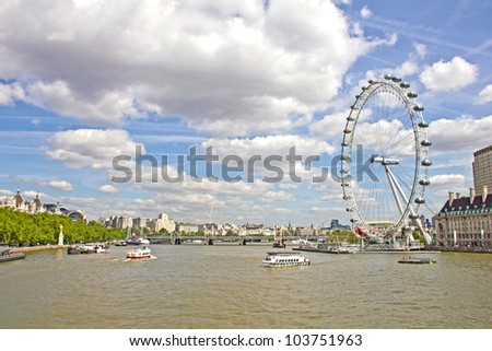 LONDON - MAY 13: The London Eye and the Thames river in London, on May 13, 2011 in London. The entire structure of the London Eye is 135 metres tall and the wheel has a diameter of 120 metres. - stock photo