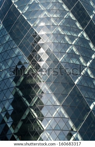 LONDON - MAY 2: The modern glass buildings of the 30 St Mary Axe, Swiss Re, Gherkin May 2, 2013, during the annual Open House event in London, UK. This tower is 180 meters tall, detail - stock photo