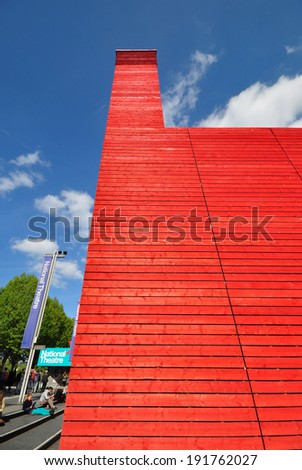 LONDON - MAY 3. 'The Shed' is the National Theatre's temporary red timber venue celebrating performences that are adventurous, ambitious and unexpected on May 3, 2014 at the South Bank, London. - stock photo