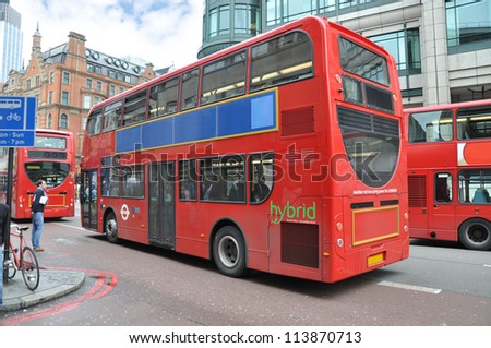 LONDON - MAY 9:The world's first double decker hybrid buses built by Wrightbus for London unveiled in 2006. They emit 40% less CO2 emissions than traditional diesel engine buses. London May 9, 2012. - stock photo