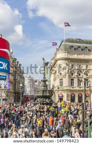 LONDON - MAY 25: Tourists in Piccadilly Circus - famous tourist attraction, road junction, built in 1819, links to West End, Regent Street, Haymarket, Leicester Square, on May 25, 2013 in London, UK. - stock photo