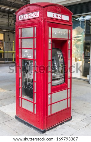 LONDON - MAY 25, 2013: Traditional Iconic red telephone box but with ATM.  - stock photo