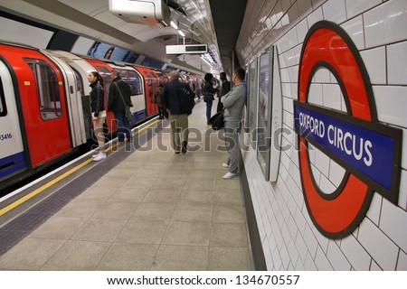 LONDON - MAY 15: Travelers hurry at Oxford Circus underground station on May 15, 2012 in London. London Underground is the 11th busiest metro system worldwide with 1.1 billion annual rides. - stock photo