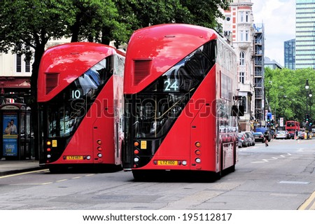 LONDON - MAY 25. Two new Routemaster diesel-electric hybrid double deck buses each accommodating 80 passengers with three doorways and two staircases, on May 25, 2014, in central London.  - stock photo