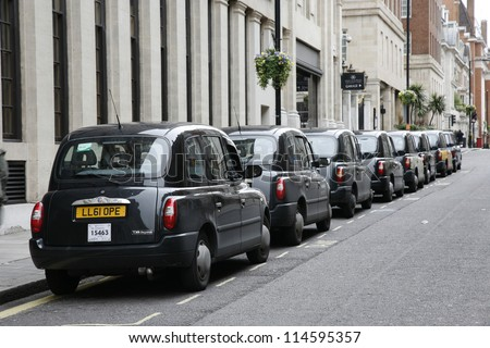 LONDON - MAY 5 : TX4, London Taxi, also called hackney carriage, black cab, on May 5, 2012 in London, UK. Traditionally Taxi cabs are all black in London but now produced in various colors. - stock photo