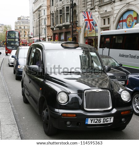 LONDON - MAY 6 : TX1, London Taxi, also called hackney carriage, black cab, on May 6, 2012 in London, UK. Traditionally Taxi cabs are all black in London but now produced in various colors. - stock photo