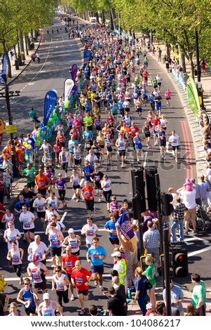 LONDON - MAY 27: Unidentified people run the London bupa 10K on May 27th 2012 in London, England, UK. The Bupa 10k is an annual event - stock photo