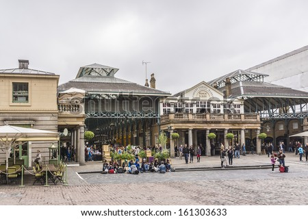 LONDON - MAY 31, 2013: View of Covent Garden market. Covent Garden - one of the main tourist attractions in London - is known for its restaurants, pubs, market stalls and shops. - stock photo