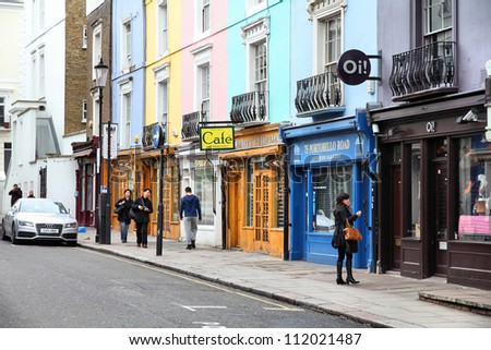 LONDON - MAY 14: Visitor watches shop windows on May 14, 2012 in Notting Hill, London. Portobello Road Market at Notting Hill currently is one of top 15 shopping destinations in London (TripAdvisor). - stock photo