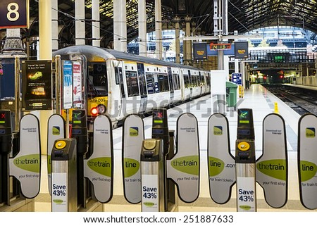 LONDON - NOV 22 : A train waiting for departure on Nov 22, 2014 in London, UK. Paddington station is one of the busiest in Europe and run more than 100 trains every hour during peak times.   - stock photo