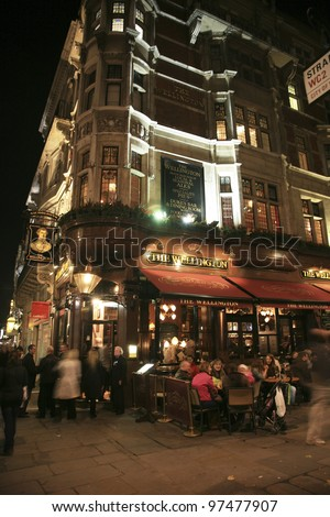 LONDON - NOV 6: Exterior of pub, for drinking and socializing, focal point of the community, on Nov 6, 2010, London, UK. Pub business, now about 53,500 pubs in the UK, has been declining every year - stock photo