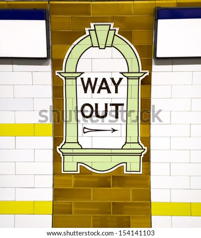 LONDON - NOV 15: Way Out sign, painted on the wall tiles in London Underground, November 15, 2012, England - stock photo