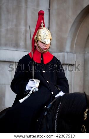 LONDON - NOVEMBER 28: A Horse Guard at the horse guard parade on 28 November 2009 in London, England. - stock photo