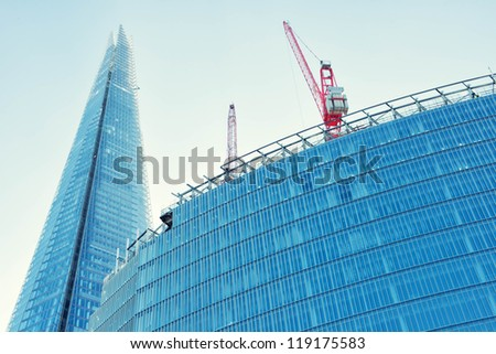 LONDON-  November 11: The glass shard building at london bridge, now complete is the tallest building in europe at over 1,000 feet (310 metres). London, November 11, 2012. - stock photo