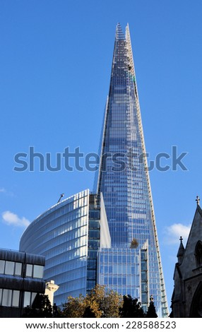 LONDON - NOVEMBER 1. The Shard skyscraper designed by Italian architect Renzo Piano has 87 storeys over a height of 1004 feet (306 metres) on November 1, 2014, in central London, UK - stock photo