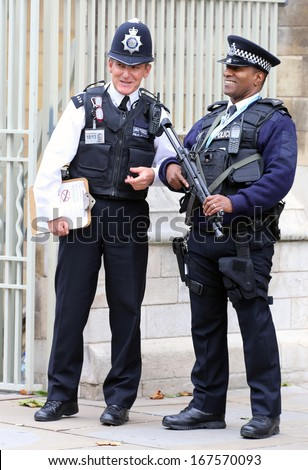 LONDON - Oct 12: Since the London terrorist bombings in July 2005, British police are prominently visible at popular tourist destinations, on Oct 12, 2013 in London, England - stock photo