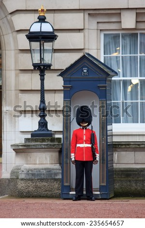 LONDON - OCTOBER 16: British Royal guards guard the entrance to Buckingham Palace on October 16, 2014 in London, UK  - stock photo