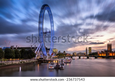 LONDON - OCTOBER 6: London Eye and Westminster Bridge on October 6, 2014 in London. The largest Ferris Wheel in Europe, structure of the London Eye is 135 meters tall and 120 meters in diameter. - stock photo