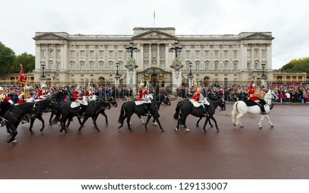 LONDON - OCTOBER 18: Marching the Queen's Guards during traditional Changing of the Guards ceremony at Buckingham Palace on October 18, 2012 in London, United Kingdom. - stock photo