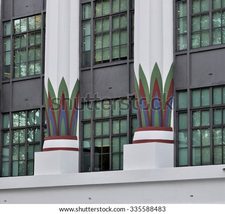LONDON - OCTOBER 31, 2015. Restored columns of the Carreras Cigarette Factory, an Art Deco design with Egyptian style ornamentation built in 1926, now offices at Hampstead Road, Camden, London. - stock photo