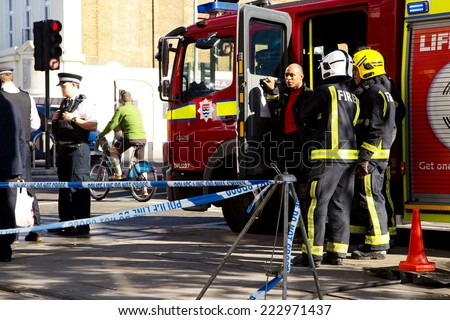LONDON - OCTOBER 11TH: The fire brigade attend an emergency in waterloo on October 11th, 2014 in London, England, UK. London's fire and rescue service is the busiest in the country - stock photo