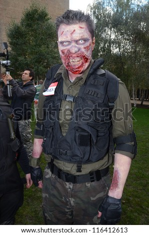 LONDON - OCTOBER 13: Unidentified man dresses as zombie celebrates World Zombie Day London 2012 on October 13, 2012 in London, England. - stock photo