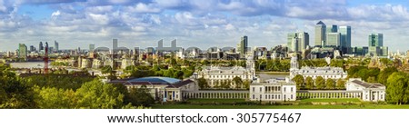 London panorama from Greenwich park, downtown, National Maritime Museum and skyscrapers of Canary Wharf - stock photo