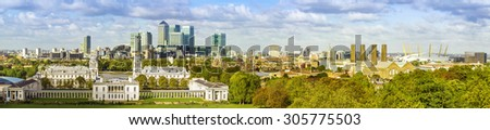 London panorama from Greenwich park, National Maritime Museum, skyscrapers of Canary Wharf and O2 arena - stock photo