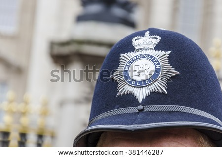 London Police Hat Badge, closeup - stock photo