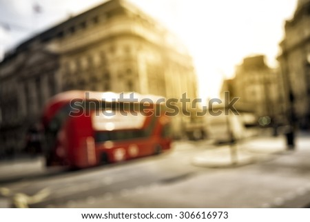 London red bus. Out of focus london panorama. - stock photo