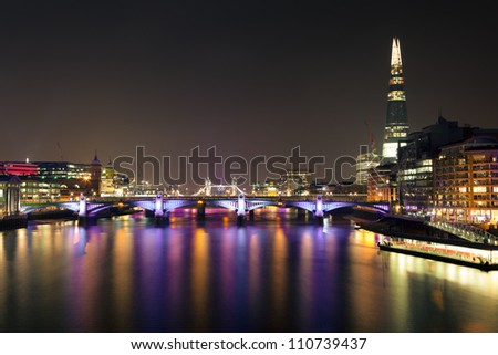 London River Thames View at Night towards Tower Bridge - stock photo