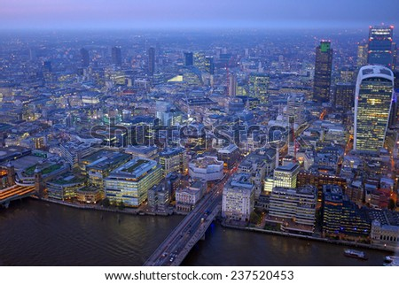 London rooftop view panorama at sunset with urban architectures and Thames River - stock photo