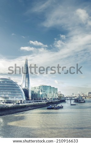 London's modern cityscape with tallest building The Shard and Town Hall on bright sky - Stock Image, VINTAGE - stock photo