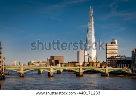 London's south bank seen from the Millennium Bridge with London Bridge, Tower Bridge and river Thames at golden hour - stock photo