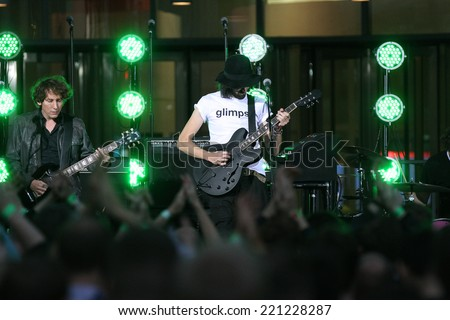 LONDON - SEP 03: Kasabian performing outside the BBC studios for the One Show on Sep 03, 2014 in London - stock photo