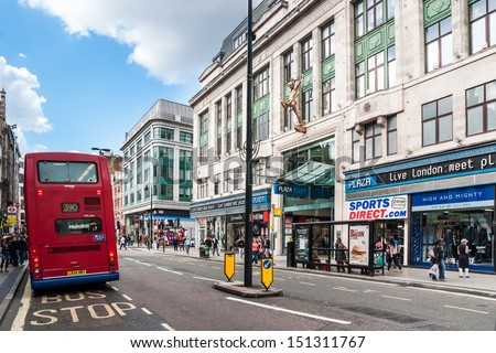 LONDON - SEP 12: Oxford Street with red double decker on September 12, 2010 in London. It's 1.5 miles (2.4 km) long major road in City of Westminster and Europe's busiest shopping street. - stock photo